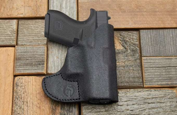 Gun In Holster Pocket