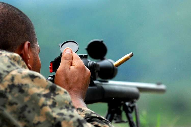 Man Shooting With Sniper